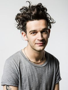 """""""With similar appreciation, Matty Healy is everything a photographer wants in a front man. Wild curls, arms dotted with tattooed doodles or cherished words, and constantly offering up self-assured poses both in full length awkward positions, to the more searching close ups. As expected for anyone involved in a rock band, the smiles were few, demonstrating instead a cool aloofness, but I liked it that way, it meant I earned them when they did appear."""""""