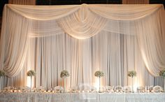Eventure custom draped backdrops create a lush atmosphere & mood behind head tables, band staging or any other focal point you wish to draw attention to.