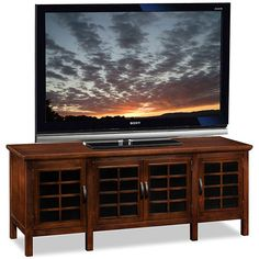 This elegant, 60-inch TV stand provides a stylish look for the living area. Solid hardwood construction makes this a durable furniture piece, holding TVs up to 62 inches. The chocolate cherry finish makes this piece perfect for almost any color interior.
