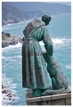 Francis Of Assisi With Dog Statue At Monterosso Al Mare, Italy