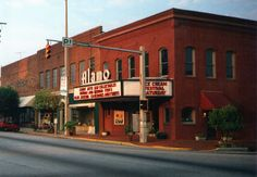 """""""Alamo Theater - *Newnan, Georgia*"""" (Late 1980s')     Opened as the Newnan Theater in 1928 it was a conversion of retail space. In 1939 it was redesigned by the GA architectural firm Tucker & Howell. The theater is located in downtown Newnan, GA. Now a retail store. ~ Photo by Onasill """"OFF"""" Traveling (Bill Badzo) - June 3 2010 - McBride, Newnan, Georgia, US """