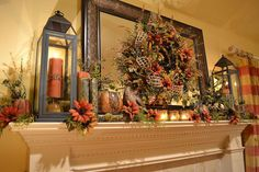I wanted my mantle to have a warm and cozy feeling for fall. I made a wreath with rusty red and gold colored sunflowers and hung it on the mirror. Then I added the lanterns with candles on each side. Oh how I love lanterns! I added some sunflowers, berries, greenery, votives, pumpkins, books and a pheasant to finish it off.