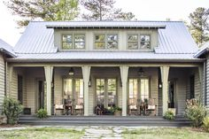 Green country cabin porch looks cozy and inviting with rocking chairs placed in front of a row of French doors. Country Home Exteriors, House Exteriors, Brandon Ingram, Cabin Porches, Southern Homes, White Houses, Small Houses, Historic Homes, House Tours