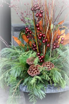 evergreens, seed pods, berries & dried grasses in classic urn ~ Winter Garden Pots | Flower Arrangements