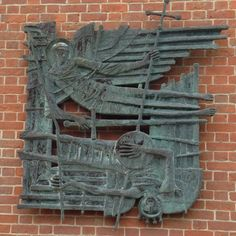 """""""Michael and his angels fought against the dragon"""" - fibre-glass bas relief by John Hayward, at the Anglican shrine at Walsingham"""