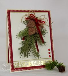 This lovely sprig is made from the Pine Pair and the Pine Sprig Cluster dies. Distress inks are used to highlight the texture on these realistic pine cones. Handmade Christmas card.