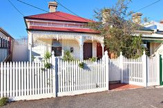 White on white Victorian cottage with red roof. 25 O'Grady Street  Clifton Hill Contact Agent @ domain.com.au