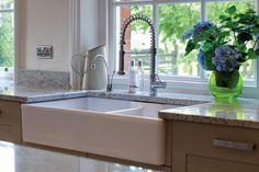Function and form, a double Belfast sink in this Arts & Crafts style kitchen from Treske