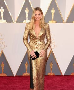Oscars 2016 Red Carpet: Margot Robbie in a Tom Ford Gold Long Sleeve Sequin Deep V-neck Gown with Forevermark Jewels