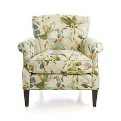 The perennially classic occasional chair sits up and takes notice, covered in fresh, painterly florals and flaunting a graceful, curving keyhole arm. Beautiful scaled-up blooms update the traditional botanical in watercolor teals, blues and warm neutrals printed on gorgeous linen. Elyse's great lines and upright yet comforting proportions are a natural for classic room settings, paired with a sofa or part of an intimate seating arrangement in living space or bedroom.