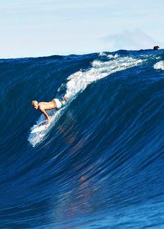 Throwback of John sliding into a big one at Teahupo'o. Photo by Tim McKenna
