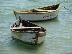 Day at the beach, old wooden boats, weathered, cracks, aged, water, waves, beauty