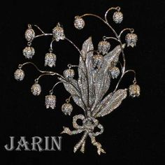 JARIN Lily of the valley diamond brooch. I love lilies of the valley in art and jewelry.