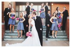 The gray dresses don't look too bad with the black suits. Add a yellow accent on the bridesmaids and  yellow boquets and it'd be so cute!