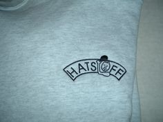 HATS OFF logo on a Gray sweatshirt front with a Saten embroidery pattern fill Embroidery Services, Embroidery Patterns, Grey Sweatshirt, T Shirt, Fill, Company Logo, Gray, Sweatshirts, Hats