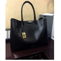 Ralph Lauren Black Purse A few months old Purse, I'm more of a small purse kind of gal. This cute purse is very elegant and has a lot of space. It's used and in good condition. Please comment for additional information or pictures. Ralph Lauren Bags Shoulder Bags