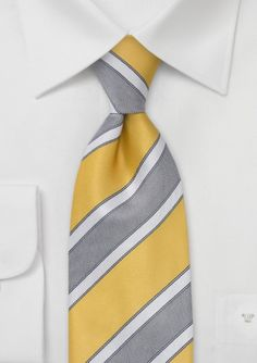 A great summer tie that looks best with stone gray suits. This tie is also perfect for a gray vest, white shirt, and matching gray pants outfit.