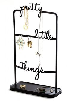 Neatly organize and display your pretty little things with this metal stand. Perforations on the metal bar keep your earrings in place while you can use the script to hand necklaces and bracelets and the base can hold any pieces you can't hang.