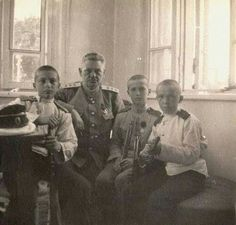 Tsarevich Alexei Nikolaevich Romanov of Russia with his tutor,Petrov and two Cadets.A♥W