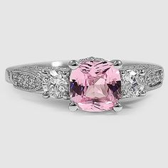 A stunning pink sapphire engagement ring.