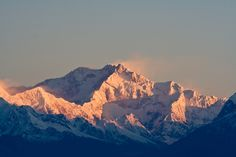 Sunrise over Kangchenjunga, as seen from Sikkim. Standing 8,586 metres (28,169 ft) tall, it is the second-highest peak in India and the third-highest on Earth.
