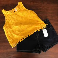 Yellow floral pattern cropped top Yellow floral pattern cropped top with Pom Pom at the end. NWT. No stains or holes. Cute with high waisted bottoms. No trades! #lilkittylady Xhilaration Tops Crop Tops