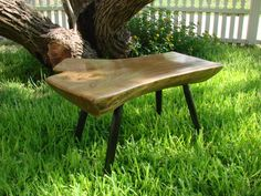 """Bench made from 1/2 elm log cut at crotch.  Legs are turned red oak, painted black.  Finish is lacquer.  Bench is 32"""" long and 18"""" high."""