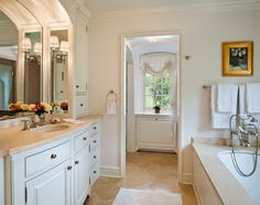 A master bath complete with a shower closet, toilet closet and plenty of counter space.  A well lit mirror and plenty of natural light.
