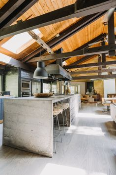 A Rustic, Renovated MCM House in the Poconos Is Also an Animal Sanctuary - The kitchen island's concrete countertops were done by Catskill artisan and friend, Lesley Steven - Industrial Kitchen Design, Mcm House, Beton Design, Modern Ranch, Round House, Concrete Countertops, Cuisines Design, House Goals, Building A House