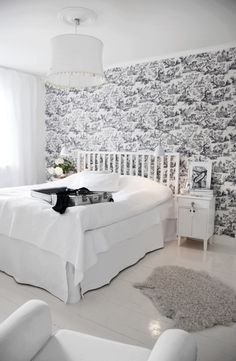 Simple white w/ toile bedroom.