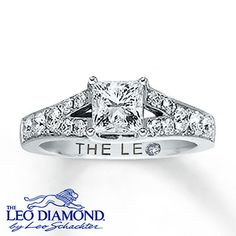 A stunning princess-cut Leo diamond, independently certified and laser-inscribed with a unique Gemscribe® serial number, is the focal point of this magnificent engagement ring for her. Brilliant round Leo diamonds add more sparkle along the 14K white gold band. The ring has a total diamond weight of 1 1/2 carats.