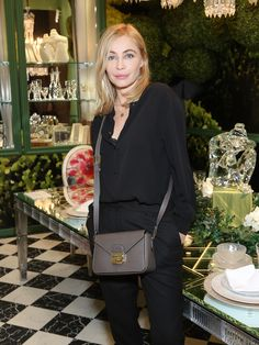French actress Emmanuelle Béart wearing the new Le Pliage Heritage crossbody bag and a black silk blouse. Photo by François Goize.