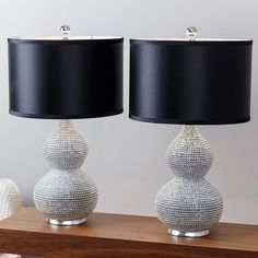 These elegant Sea Urchin table lamps from Abbyson Living add a glamorous touch to your home decor. The pair is made of resin with faux-silk shades, providing both durability and a deceptively luxurious look.