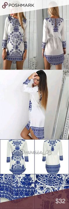 White with Blue Design Tunic/Mini-Dress White with Blue Design Hi-Low Tunic/Mini-Dress. Removable Tie String.   *** MIGHT NOT BE AS LONG ON YOU AS ON THE MODEL ***  This is NWOT Retail. Price Firm Unless Bundled.  Measurements Available Upon Request. Dresses Long Sleeve