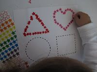 Fine motor- tracing shapes with stickers.  Brilliant!