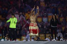 Olympians Kaori Icho of Japan, Pita Taufatofua of Tongo and Yusra Mardini of the Refugee Olympic Team dance on stage during the Closing Ceremony on Day 16 of the Rio 2016 Olympic Games at Maracana Stadium on August 21, 2016 in Rio de Janeiro, Brazil.