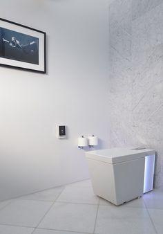 Numi toilet   Ann Sacks carrara marble field tile