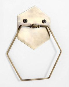 "Hexagonal towel ring crafted from antiqued metal Predrilled holes for easy placement Complements almost any décor Towel not included UO Exclusive 5""l, 6.5"""
