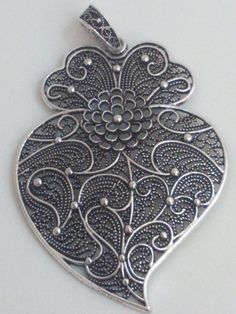Hey, I found this really awesome Etsy listing at https://www.etsy.com/listing/232897157/filigree-pendant-silver-portuguese-75-cm