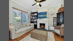 Nice white brick fireplace in the small living room very quaint. #fireplace