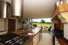2010 Wayside House Kitchen built & designed by Derry Construction Limited hand painted units with walnut & granite tops, limestone floors, Rayburn & Smeg ovens.