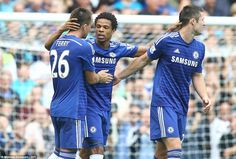 Defenders John Terry and Gary Cahill congratulate Loic Remy after the Frenchman scores on his Chelsea debut
