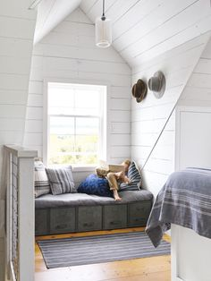 The upstairs loft, which Josh and his dad added to the original house plan, provides a surprising amount of storage. Drawers beneath the bed and window seats house the bulk of the couple's clothing.