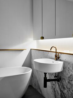 Bathroom | Hampton Penthouse. Interior design by Huntly, photo by Brooke Holm