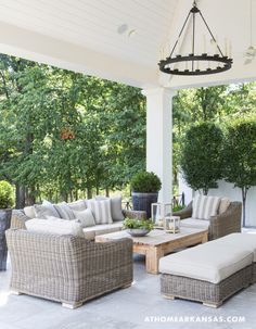 A Contemporary Classic An arrangement of wicker furniture creates a cozy conversational area on the back patio. Outdoor Areas, Outdoor Rooms, Outdoor Furniture Sets, Outdoor Decor, Outdoor Seating, Backyard Furniture, White Wicker Patio Furniture, Deck Furniture Layout, Screened In Porch Furniture