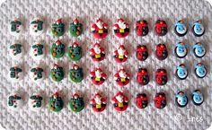 The Christmas Team : handmade polymer buttons (snowman, goblin, Santa Claus, reindeer and penguin) for scrapbooking and creation. // Boutons de Noël faits main en fimo (l'équipe du Père Noël au complet : bonhomme de neige, lutin, renne et pingouin) pour vos créations scrapbooking, cartes, pages, tags ou agrémenter une étiquette cadeau. // On sale at / A vendre sur : http://scrap-ines.over-blog.com/article-christmas-team-gourmandises-de-noel-collection-noel-2012-112952898.html
