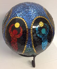 """SECOND PLACE. """"Goddess Ball 2"""" - side 1. Artist: Brenda Jolin. """"Just For Fun Contest"""" 2014 entry in Mosaics category. Stained Glass Express, Waterville Maine."""