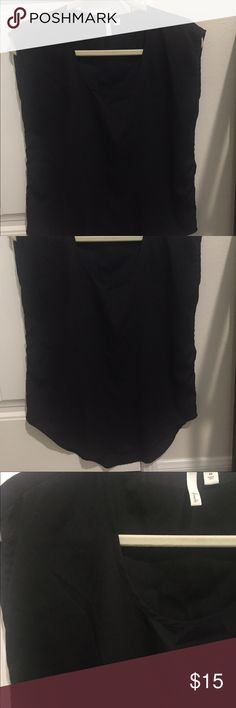 Basic black woven top This has a satin feel to it. It is sleeveless/capsleeve. Not a complete tank but not a complete sleeve. It has a U shaped hem. Frenchi Tops