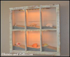 Beach Shadow Box (Source Unknown) old window frame + sand + shells and other accents + lights You can find lots of window frames at Habitat for Humanity for really cheap.