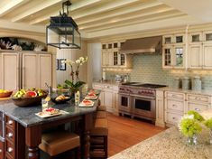 We've chosen our 48 favorite kitchen designs. From traditional to modern, elegant to cozy and casual, these rooms are true hearts of the home.